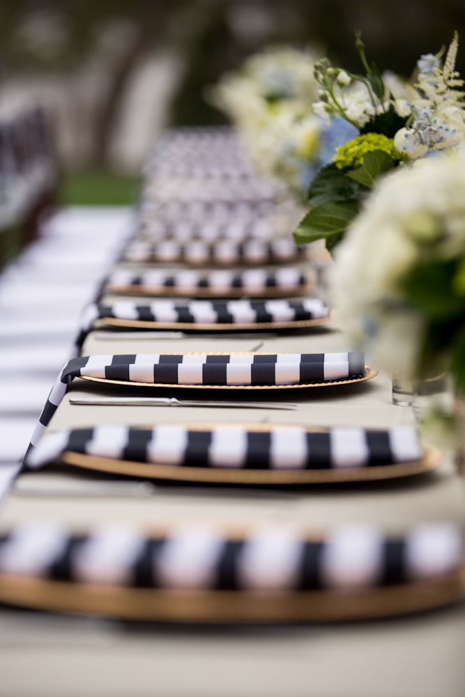 www.JohnCainPhotography.com  Erica & Eric infused modern monochrome details like these linens into their traditional wedding tablescape.