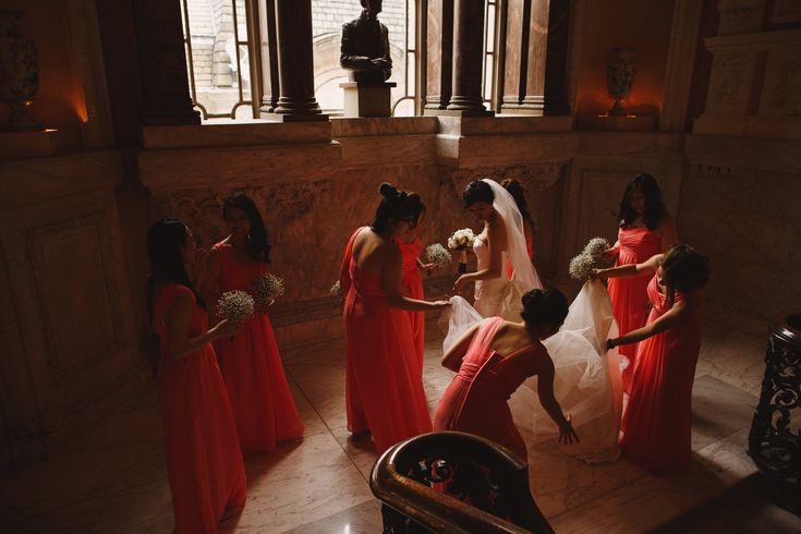 Bridesmaids and bride apply finishing touches before the ceremony in London at Dartmouth House.