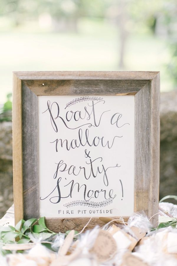 Could this s'mores sign be any cuter? http://www.stylemepretty.com/ohio-weddings/columbus/2015/09/30/romantic-outdoor-bohemian-woodland-wedding/ | Photography: Leigh Elizabeth - http://www.leighelizabeth.com/