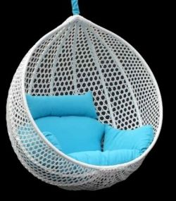 Hanging Rattan Chairs - the egg shaped hanging chairs have a very 1960's vibe.