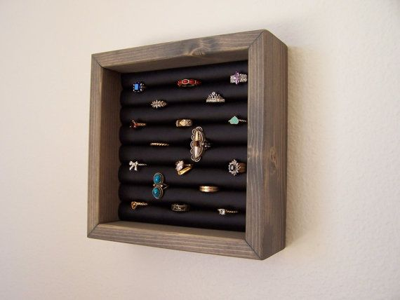 This grey stained ring holder will hold approximately 42 rings. Use it to organize and display your ring collection
