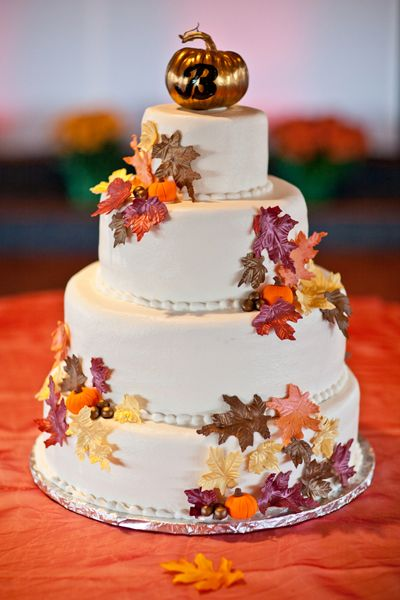 Autumn Cake    From the gilded pumpkin cake topper to the autumnal leaves, this cake screams fall.