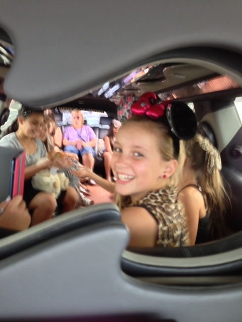 A great group of children enjoying a ride in our limousine for a 10th birthday party - During the ride