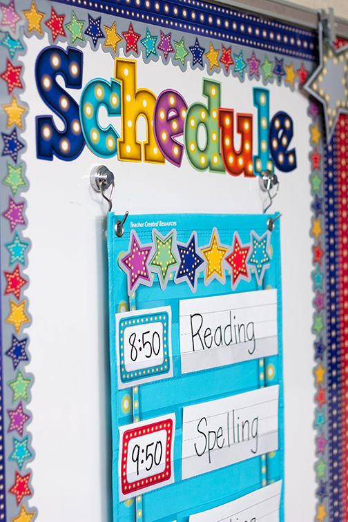"Create your own classroom schedule with the Light Blue Marquee 14 Pocket Chart - These lightweight and durable pocket charts feature colorful designs and hang easily from sturdy, metal grommets. Measures 13"" x 34""."