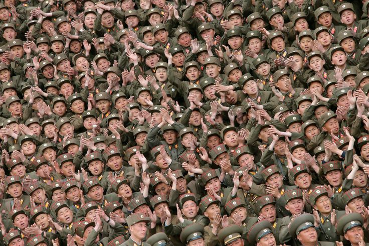 Soldier-builders of KPA Units 966, 462, 101, 489, who took part in building the workers' hostel of Kim Jong Suk #Pyongyang Textile Mill, applaud during a photo session with North Korean leader Kim Jong Un. May 6, 2014. Soldier-builders of KPA Units 966, 462, 101, 489, who took part in building the workers' hostel of Kim Jong Suk Pyongyang Textile Mill, applaud during a photo session with North Korean leader Kim Jong Un. (KCNA—Reuters)