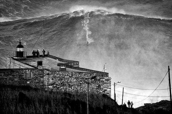 Photo of the biggest wave ever surfed. Garrett McNamara surfed this 100 foot wave in Nazare, Portugal.