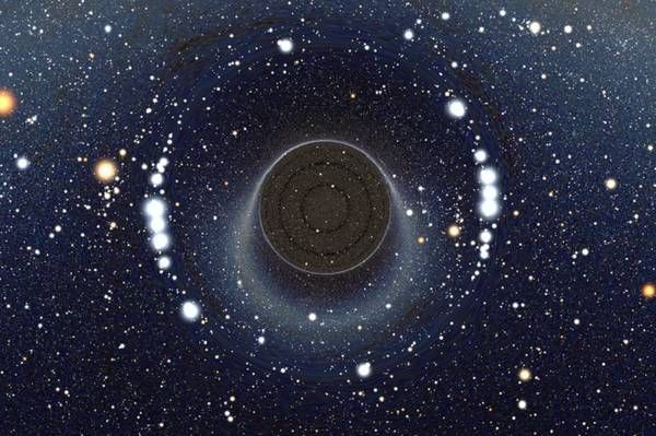 """Viaggiare nello spazio e nel tempo, tuffandosi nei buchi neri e sfrecciando all'interno di un cunicolo spaziotemporale, un wormhole come quelli immaginati nel film Interstellar: sembra fantascienza, ma """"diventa concepibile"""" dopo la scoperta delle onde gravitazionali  (ANSA)"""