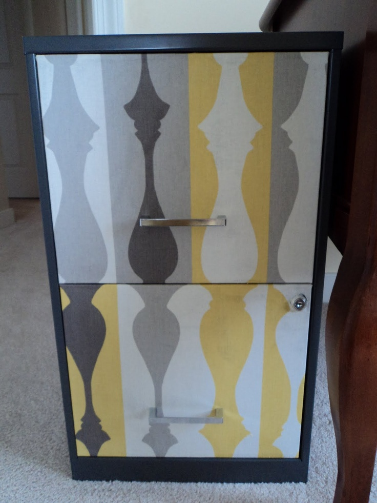 cover file cabinet front with fabric - great idea for home office in an open area like dining room or living room