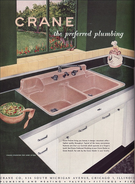 1951 pink kitchen sink. Nice shape with the raised fixtures and areas for soap and sponge. Like.