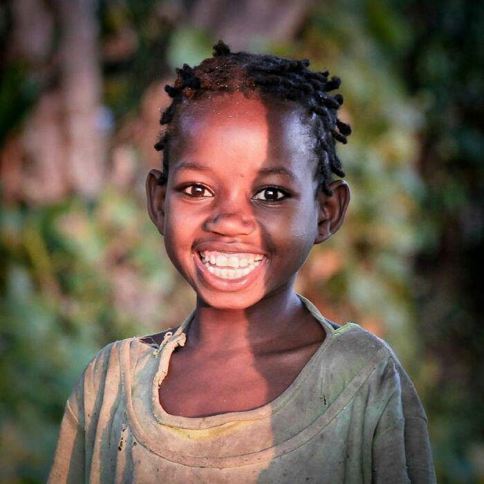 Love her beautiful smile! Africa