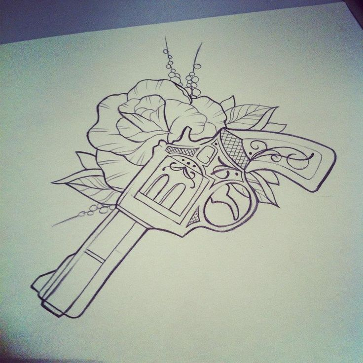 by Marita Butcher-I dont think I would get a gun tattoo but its really pretty