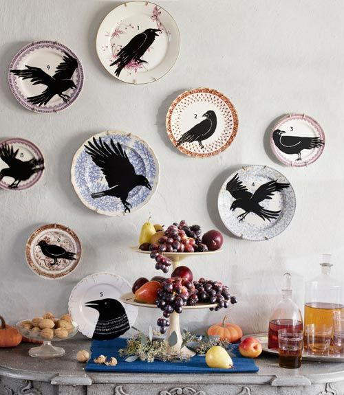 I like this display.  I'd like the idea of finding plates at garage sales and thrift shops and putting something like this together to unify it.