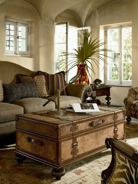 Fabulous trunk/coffee table with turned feet, zebra chair...and muted throw pillows....gorgeous!
