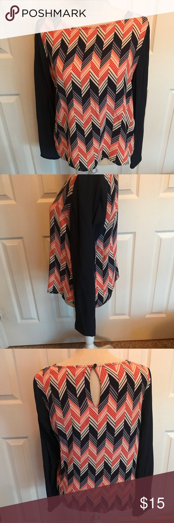 Gap Chevron Top Sz Small Super cute Top from The Gap in EUC! Chevron orange, white and navy blue pattern. Navy blue long sleeves. Key hole cut out in back. Size small. GAP Tops