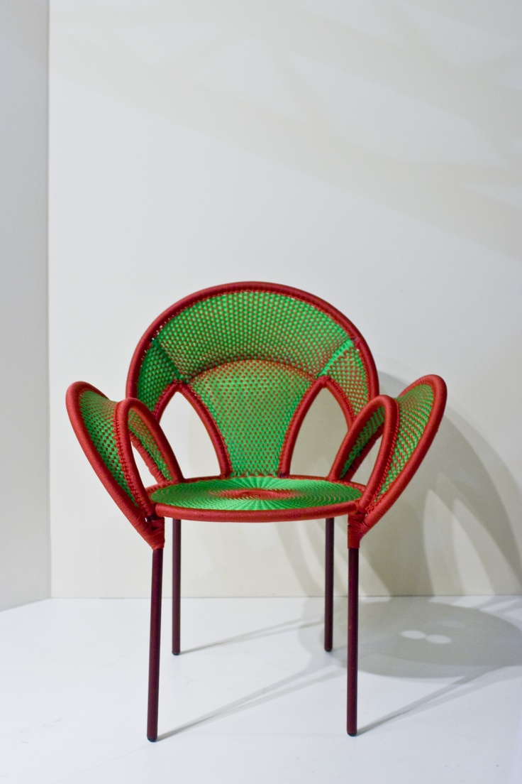M'Afrique for Moroso, 2013, Sebastian Herkner.  This chair, and particularly the shape of its armrests, is inspired by the mating dance of male ostriches - banjooli in Wolof language - who stretch out their wings to show off their beauty to the female.