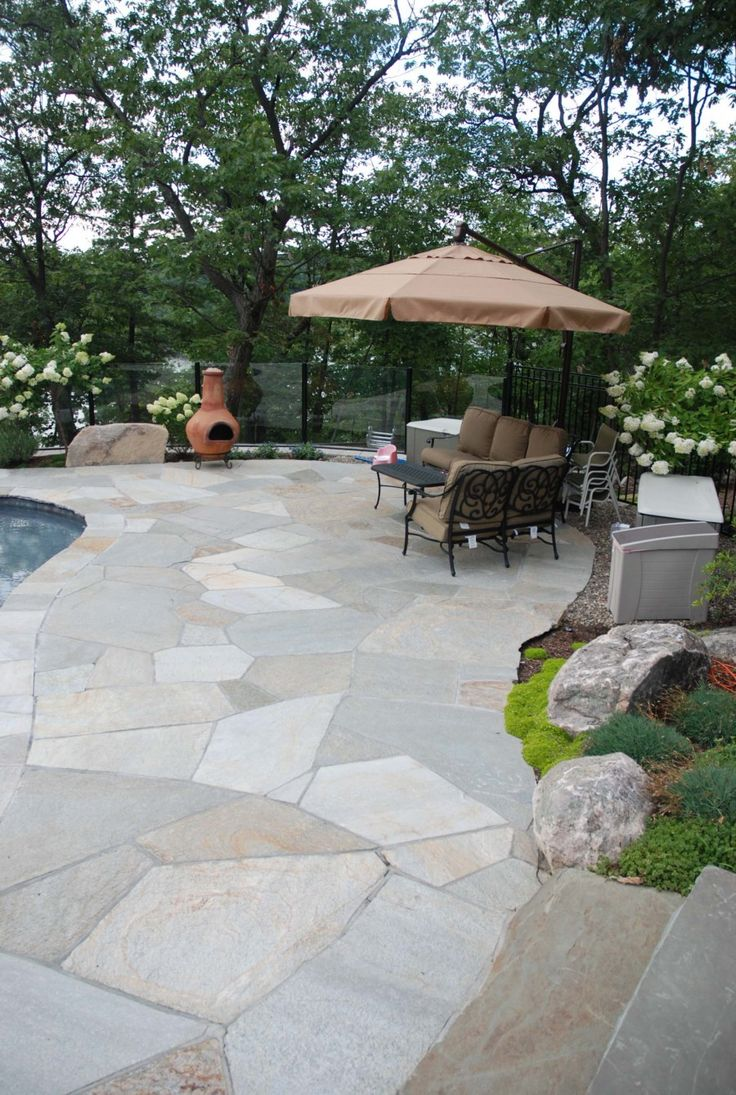 rocky mountain quartzite patio we design and install all types of stone and paver patios - Driveway Patio Ideas