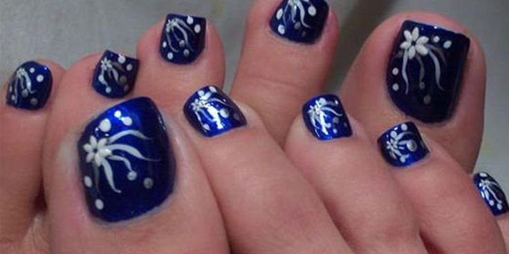 Fancy Blue Toe Nail Design With White Flowery Polish Effect For Girl