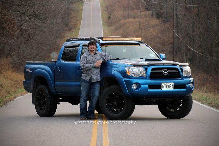 High school Senior pose inspiration; Posing on the road with his truck.  #senior #seniorportraits #seniorpictureideas #truck #road #lift #toyota #bluetruck #lights #lightbar #liftedtruck #guys #lakeozark #lakeoftheozarks #sarahmcphoto