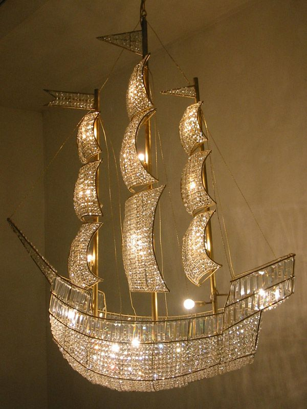 The ship of lights takes me to the land of lights.  So that must be the stars.