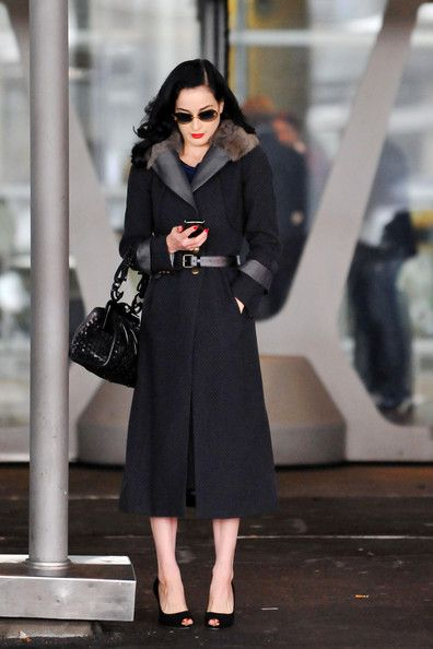 Dita Von Teese Dita Von Teese arrives to Paris with several bags of luggage. She looks through her phone before catching a taxi back to her ...