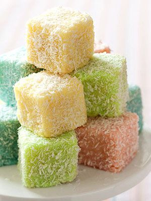 Traditional Australian finger cakes, known as Lamingtons. Trim Yellow cake into squares, spoon food coloring tinted lemon sugar glaze over squares, press coconut into sides, cool and Eat!