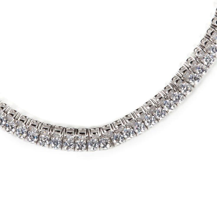 A luminous sweep of #zircons evokes a chic #fashion style.