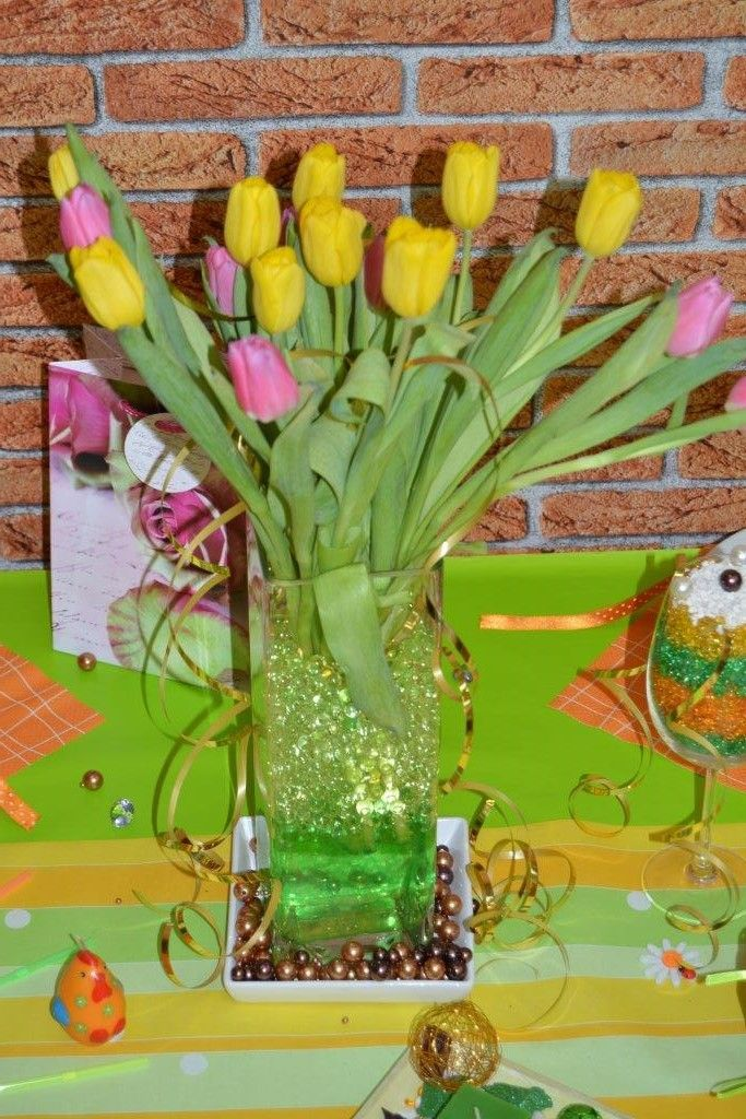 Tulips in a vase with aqualinos