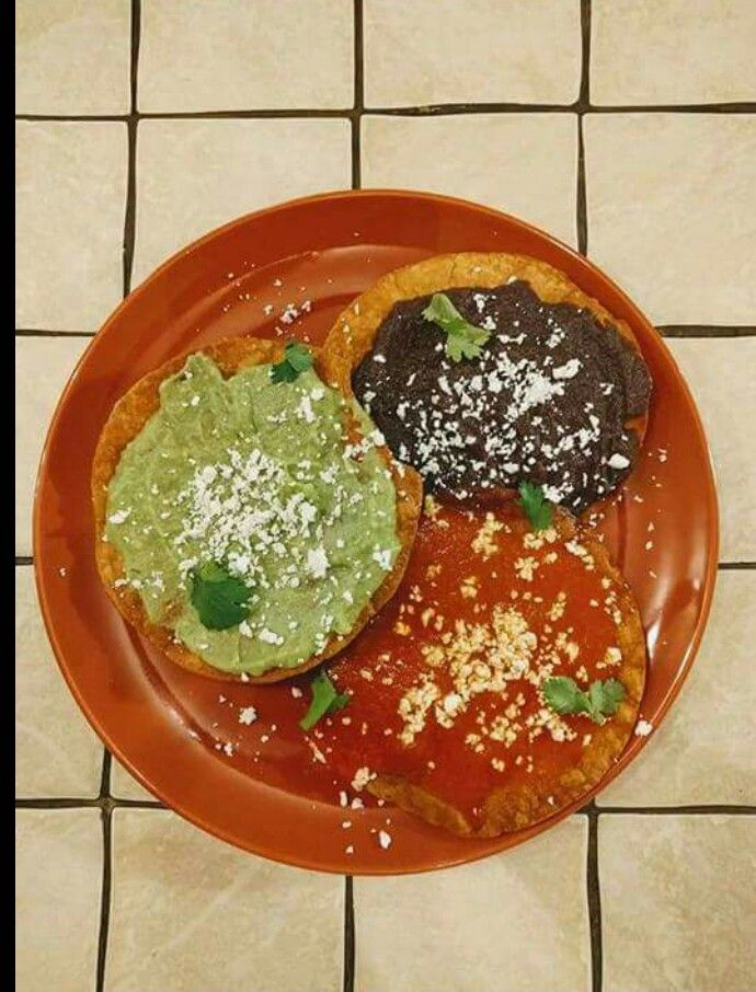Tostadas Frijol Salsa y Guacamol Fried Tortilla with Tomato Sauce/Black Beans and Guacamole on Top