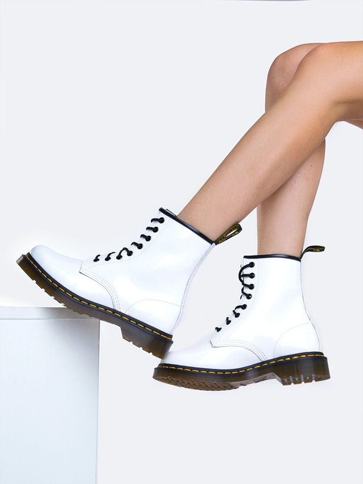 "Brand: Doc Martens Style: Booties Color: White Blanc Material: Patent Lamper; classic patent leather Platform Height: Approx. 1"" Heel Height: Approx. 1 1/2"""