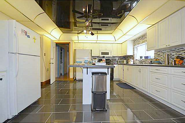 Lovely WHITE cabinets... a great contrast with dark flooring!
