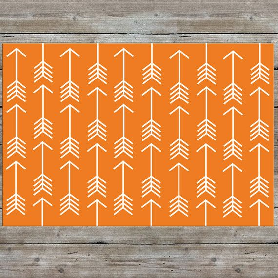 A pattern of arrows printed on a soft plush rug. This rug would look great in a nursery, kids room, etc. Colors can be customized to complement