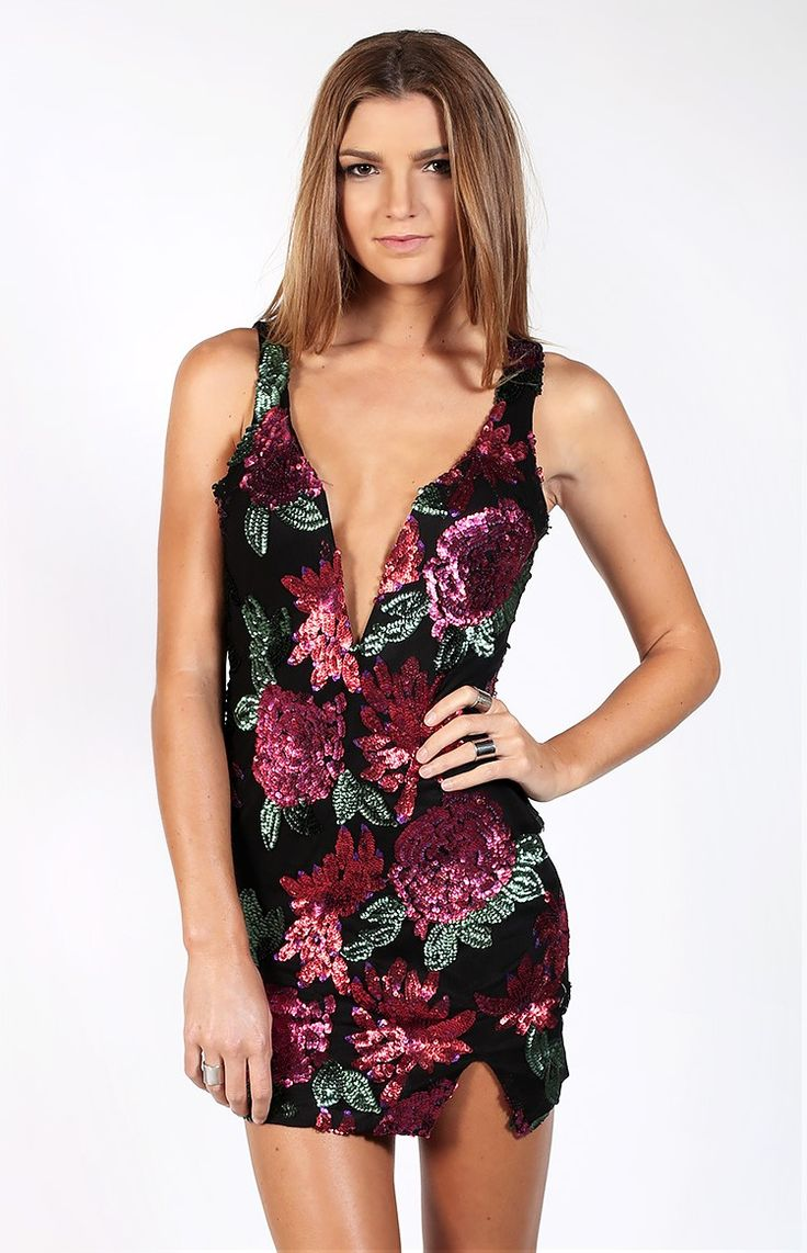 Shine On Dress. Shine brighter then a diamond in the Shine On Dress! Made on a black material, fitted body, this stunner features a floral beaded front, plunging 'V' bust with wiring, and small leg split on the front side