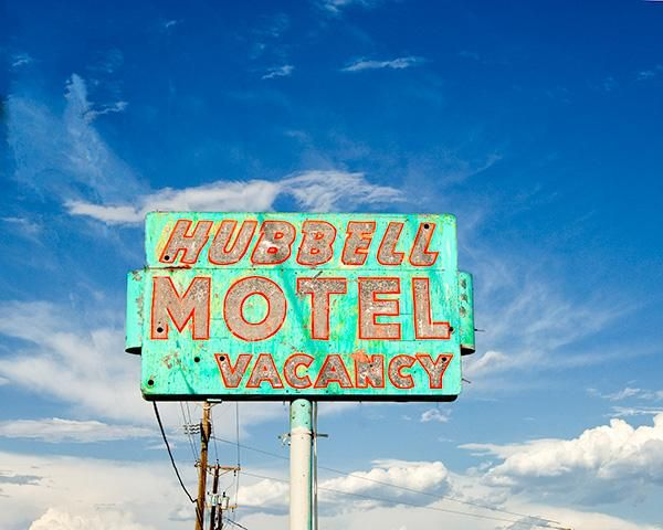 'Hubbell Motel' sign in Albuquerque, New Mexico on Historic Route 66. Mason Hubbell opened this motel in 1952 for the increasing tourist trade driving along Route 66. Mason was wise to keep things simple, but clean. He offered the best overnight rates anywhere around the area. There were no TVs, no phones, no 'Magic Fingers' beds and no refrigeration in every room, only a few had the whole enchilada. He found that if you could price an over night stay for $15.00, you would be full every…