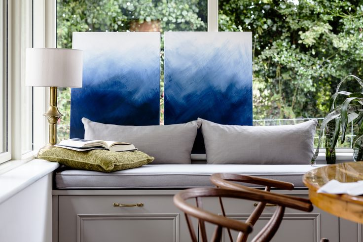 Bespoke bench seating with abstract paintings and wishbone chairs. By Kingston Lafferty Design. www.kingstonlaffertydesign.com