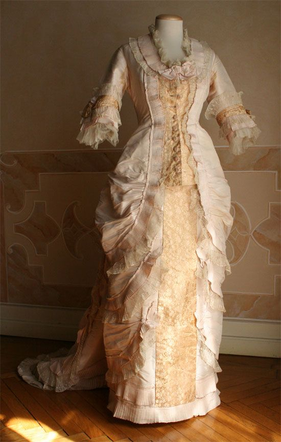 An extant version of the style of dress seen in Tissot's painting previously posted. Lace dress, 1875   The buttons, the bows and the ...