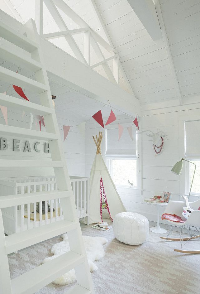 Fun White Nursery. This nursery boasts an Eames Molded Plastic Rocker, Saarinen Side Table and white Moroccan leather pouf atop a Capel Rugs Junction Pink Flatweave Wool Rug.