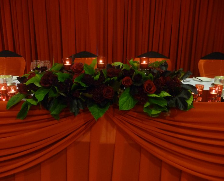 Red rose bridal table florals. Styled by Greenstone Events.