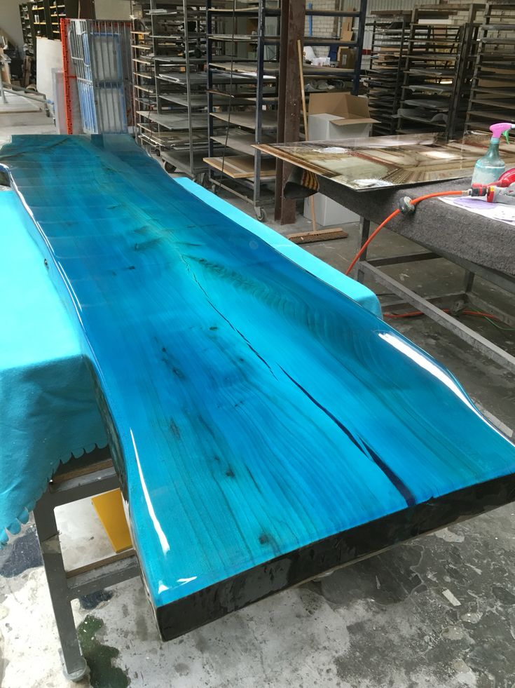 Tabletop from elm With transparent epoxy Colour resin. Designed by ccoating