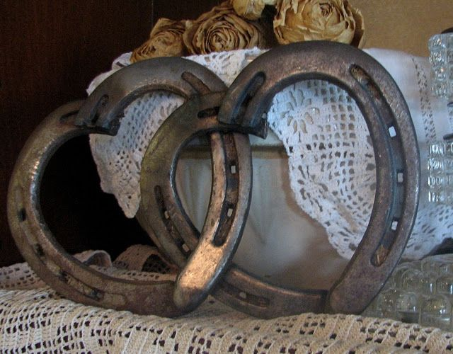 Horseshoes welded together to form hearts.