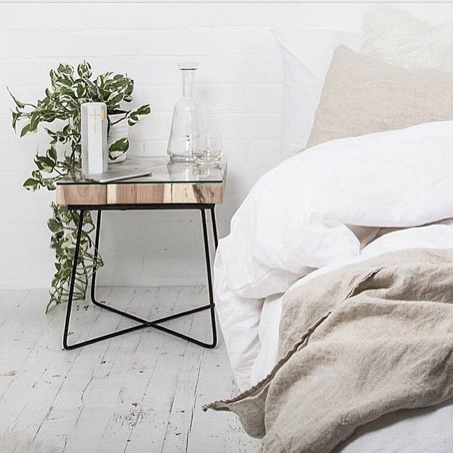 comfy bed with glam bedside table