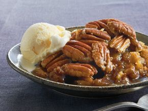 Yummoo!! Pecan Pie Cobbler 1 box Pillsbury® refrigerated pie crusts, softened as directed on box 2 1/2 cups light corn syrup 2 1/2 cups packed brown sugar 1/2 cup butter, melted 4 1/2 teaspoons vanilla 6 eggs, slightly beaten 2 cups coarsely chopped pecans Butter-flavor cooking spray 2 cups pecan halves Vanilla ice cream, if desired