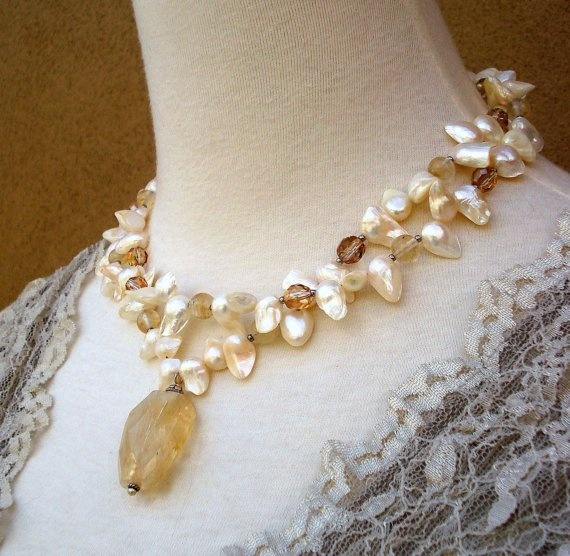 """Bought this as a modern alternative to a """"mother's ring."""" Pearl = June baby, Citrine = November baby."""