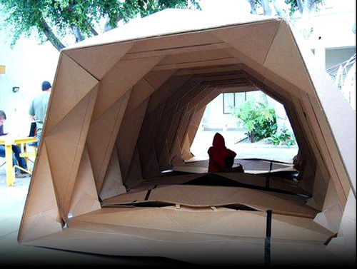 """Borrowing principles from the art of Japanese paper folding, USC School of Architecture grad Tina Hovsepian invented Cardborigami, a temporary and ultra-portable shelter that can be used by the homeless. The shelter is made from standard corrugated cardboard, a lightweight and cost effective material. Incorporating a consistent pattern of x's and parallel lines, Tina created a structure that can fold down for portability, but also open up to create the makeshift """"walls"""" of the shelter."""
