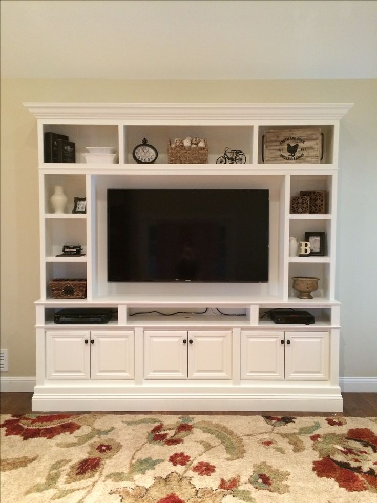 "This is my DIY Built In / Wall Unit made for 60"" TV. I used three in stock brown maple Home Depot upper kitchen cabinets (30"" wide x 18"" high x 12"" deep), plywood, bead board, 1x2 & 1x3 boards and some decorative moulding! The cabinets required three coats of primer and five coats of paint. I used Olympic Interior Latex paint in Satin finish. The color is ""Crumb Cookie""."