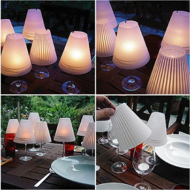 These can be purchased, but would be easy to make. Parchment shades are printed with whimsical designs in a faint white. Just set them atop a wine glass with a tea light candle inside and voila, you have instant miniature lamps.