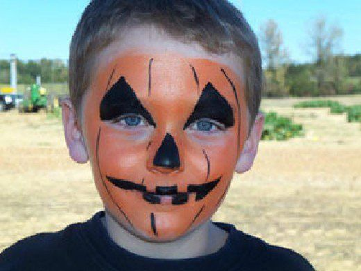 Here are tips, tutorials, and a photo gallery for pumpkin face painting designs that cover the cheek or the entire face.