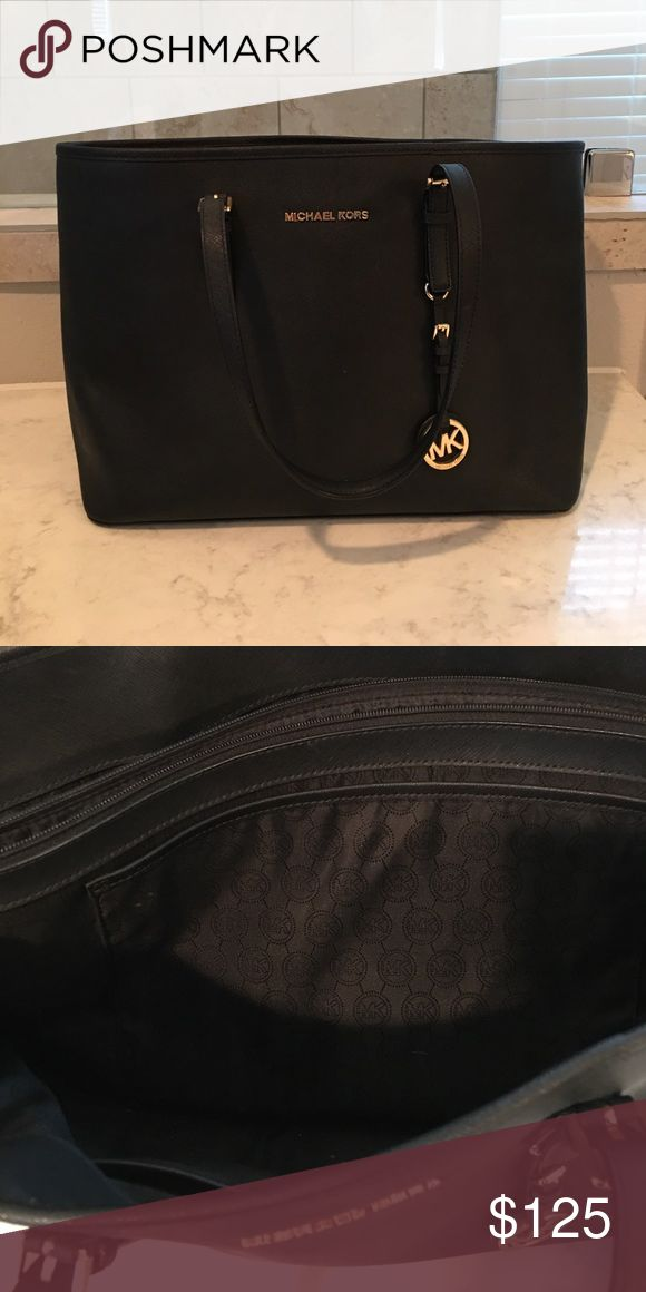 "Michael Kors Jet Set Large Tote Great Condition! Has a large zip pocket in the center perfect for your iPad or laptop. A 13"" MacBook fits perfectly Michael Kors Bags Totes"