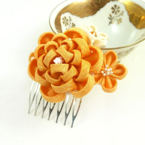 A lovely peach-colored kanzashi made from a unique kimono silk