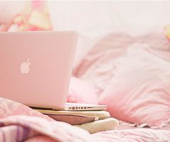 Pink apple notebook.