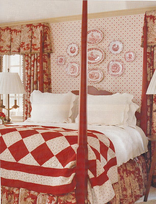 I like this bedroom with the mix of patterns and plates on the wall . . . but I'd rather use brown or green with white.